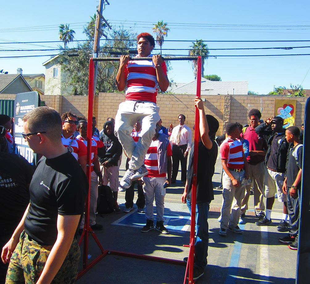 A View Park High rugby student-athlete tests his mettle during the pull-up bar challenge.