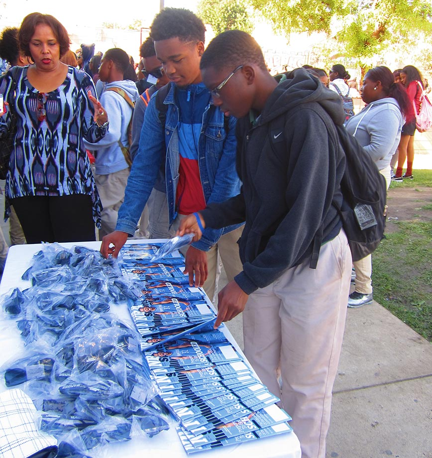 View Park High students received free sunglasses, water bottles and copies of Sports Illustrated, courtesy of SI and the U.S. Marine Corps, at an event to honor classmate Nia Toliver as SI's High School Athlete of the Month.