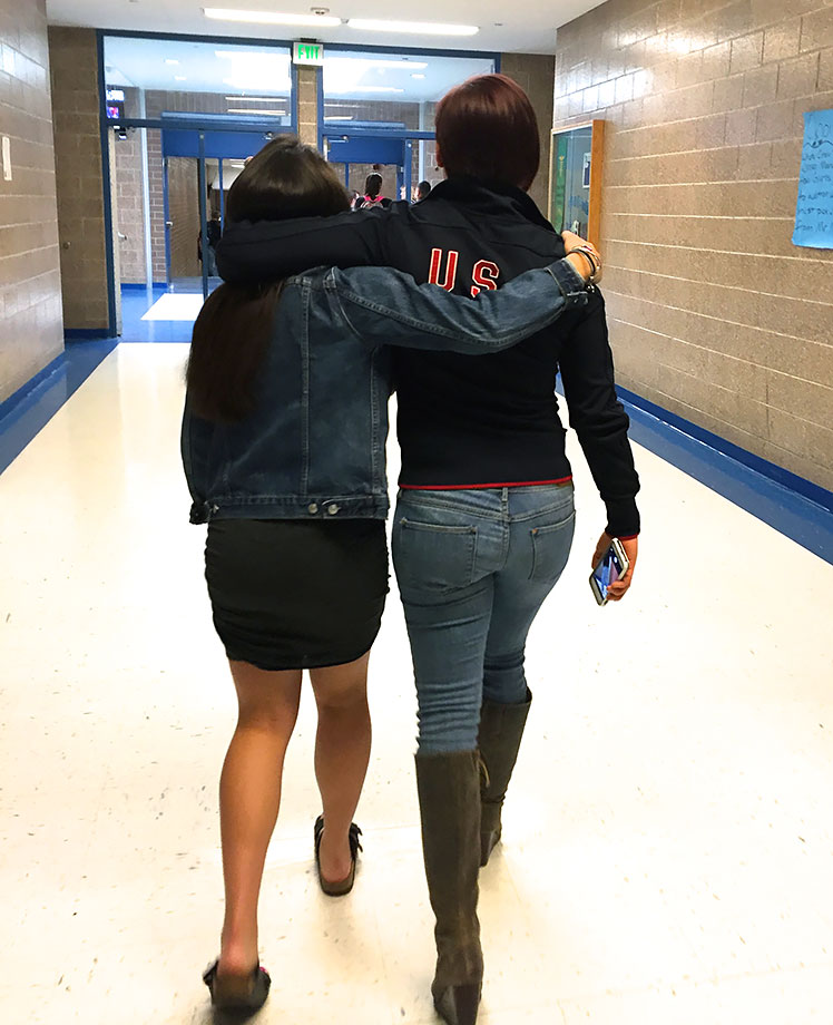 Sophia walks arm-in-arm with her Olympic Junior Development coach, Arielle Martin, who surprised her at the event. Sophia, who is too young to compete at Rio in 2016, aspires to reach the Olympics in 2020.