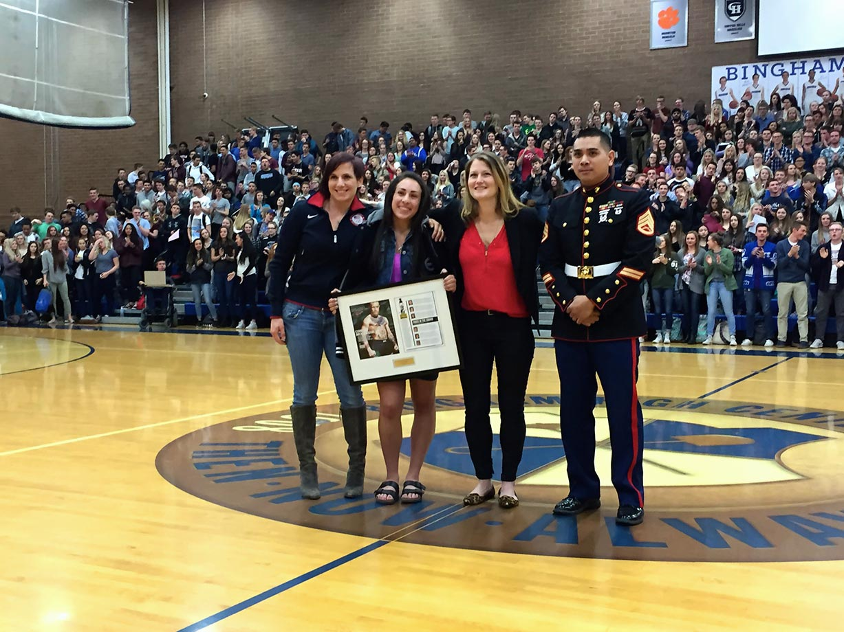 Sophia was honored in front of her classmates at an all-school assembly on Wednesday. Pictured from left to right are: World Cup BMX champion, 2012 Olympic qualifier and Team USA Olympic Junior Development coach, Arielle Martin; Sophia Foresta; SI's High School Athlete of the Month editor Ali Fenwick and SSgt Virak Keo of the U.S. Marine Corps.