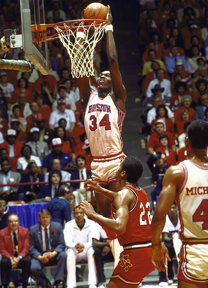 "The Cougars earned the immortal nickname ""Phi Slamma Jamma"" for their acrobatics, but Olajuwon's presence in the post is what propelled them to three Final Fours. He averaged a double-double during his sophomore and junior seasons, leading the nation in rebounding as a junior with 13.5 per game. Houston lost in the national championship game during his final two years. In those two seasons Olajuwon averaged 19.1 points and 12.2 rebounds in the NCAA tournament."