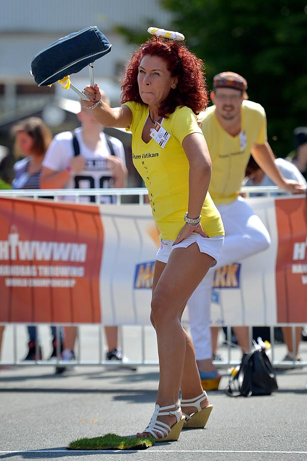 A participant launches a handbag in the 4th annual World Handbag Throwing Championships in Germany.