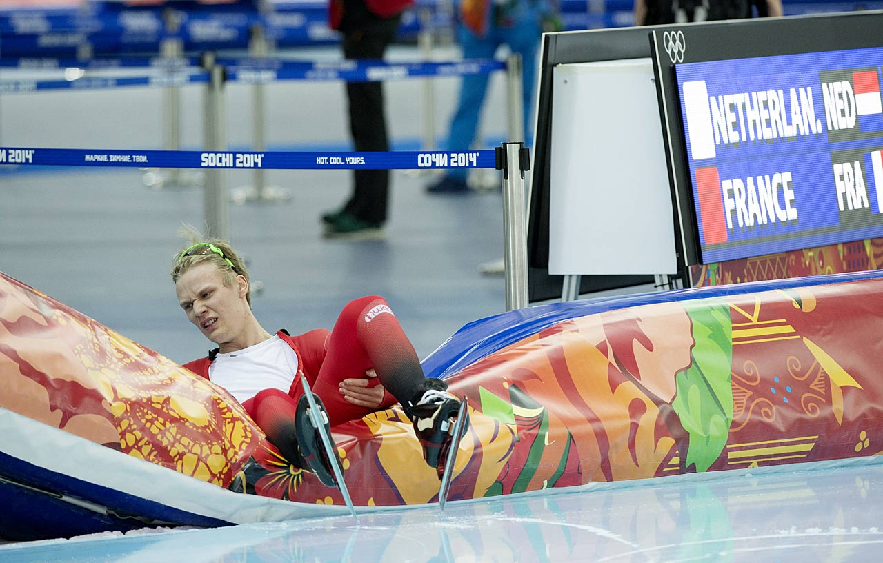 Havard Lorentzen of Norway gets a sense of his surroundings after crashing during the speed skating competition.