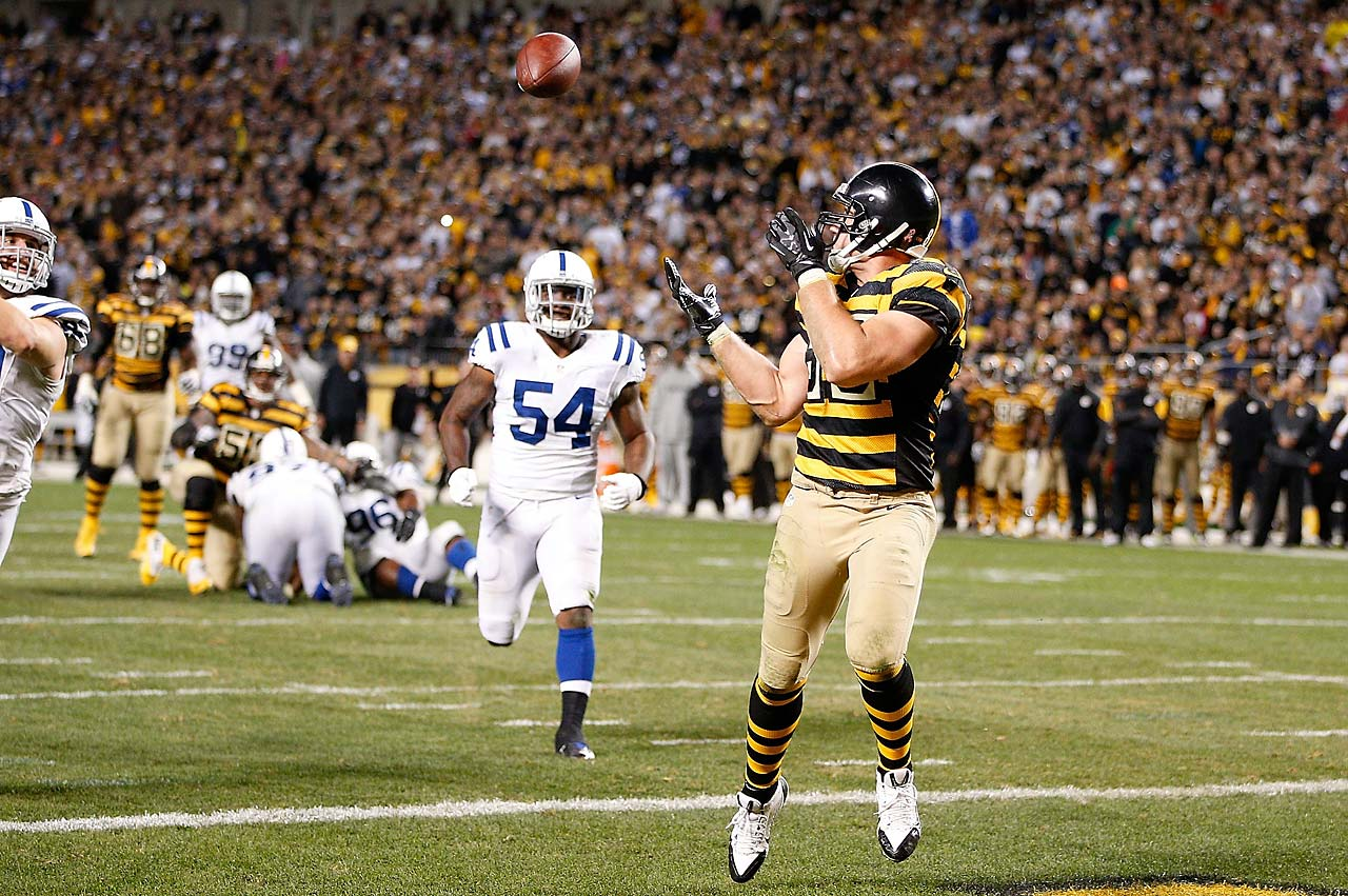 Pittsburgh tight end Heath Miller catches a touchdown pass during the fourth quarter on a day when Ben Roethlisberger threw for six touchdowns and 522 yards, both franchise records .