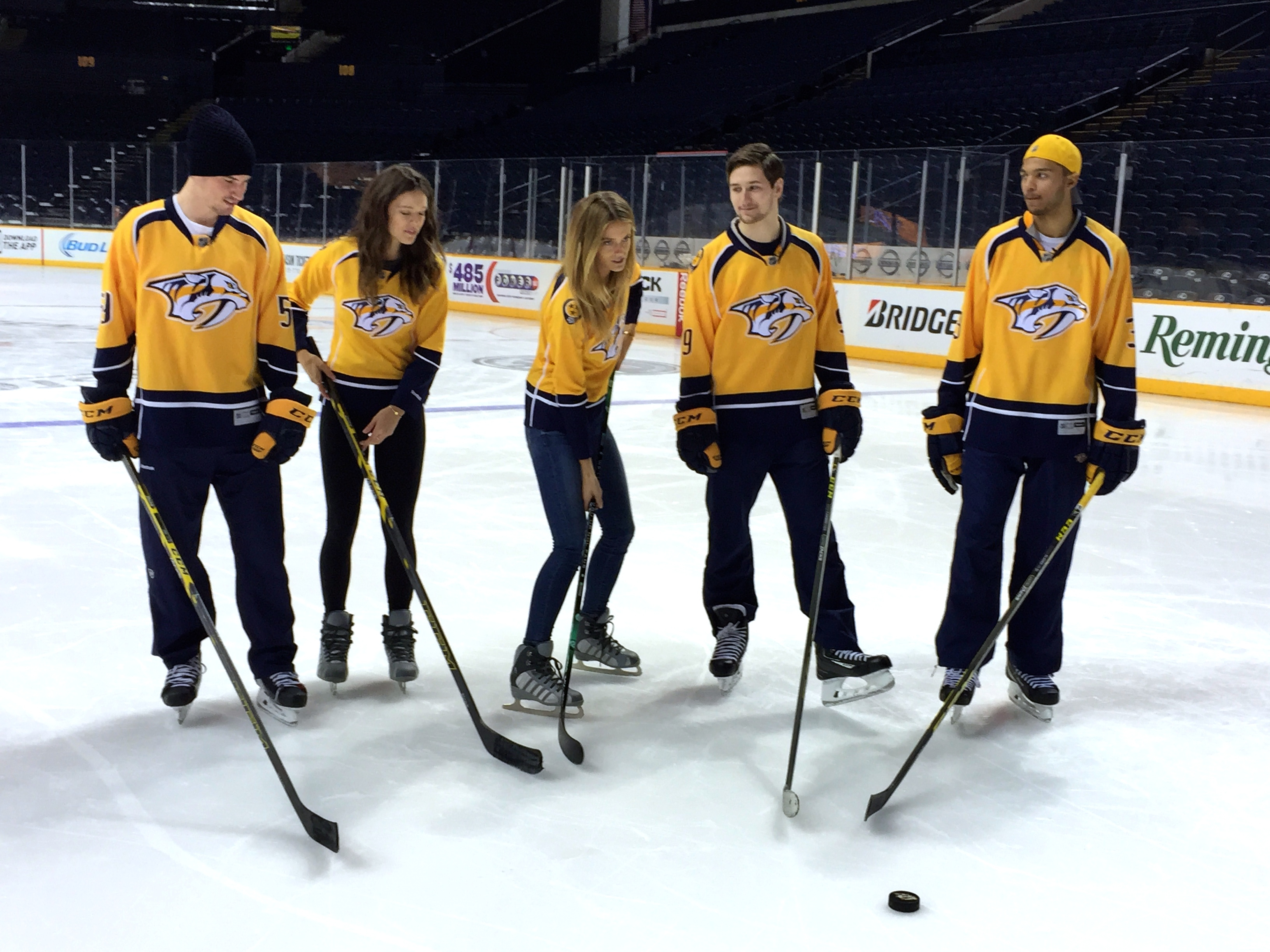 Kate Bock and Emily DiDonato film with the Nashville Predators.