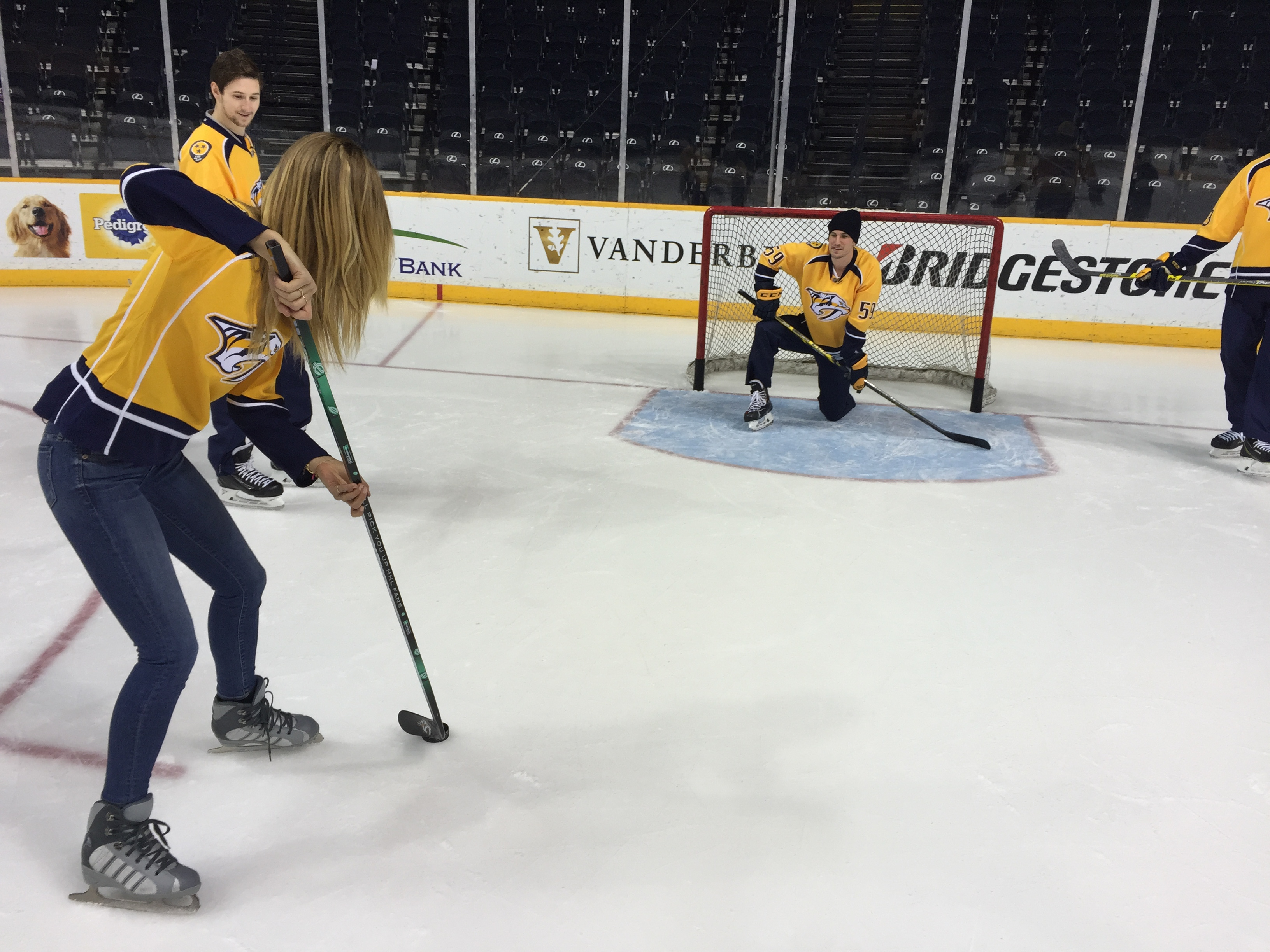 Kate Bock learns to perfect her slap shot.