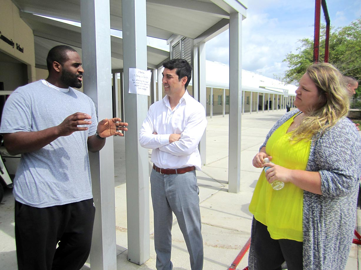 Timber Creek High grad and NFL center Lemuel Jeanpierre, left, dropped by to help celebrate Savannah. Here he talks with SI managing editor Chris Stone and Olympic weightlifter Holley Mangold.