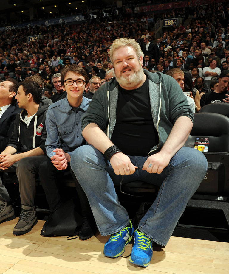 Isaac Hempstead-Wright and Kristian Nairn attend an NBA game between the Toronto Raptors and Chicago Bulls on Feb. 19, 2014 at the Air Canada Centre in Toronto.