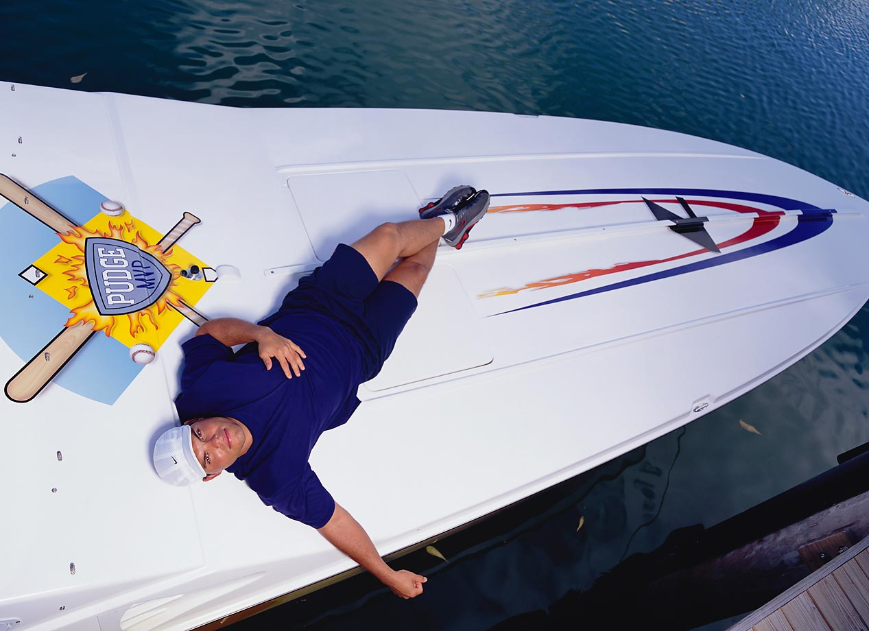 The power-hitting, rifle-armed catcher relaxes on his boat in December 2001. As the graphic on the boat references, Rodriguez was the 1999 American League MVP after hitting .332 with a career-high 35 home runs. The 14-time All-Star was a member of the 2003 World Series champion Marlins.