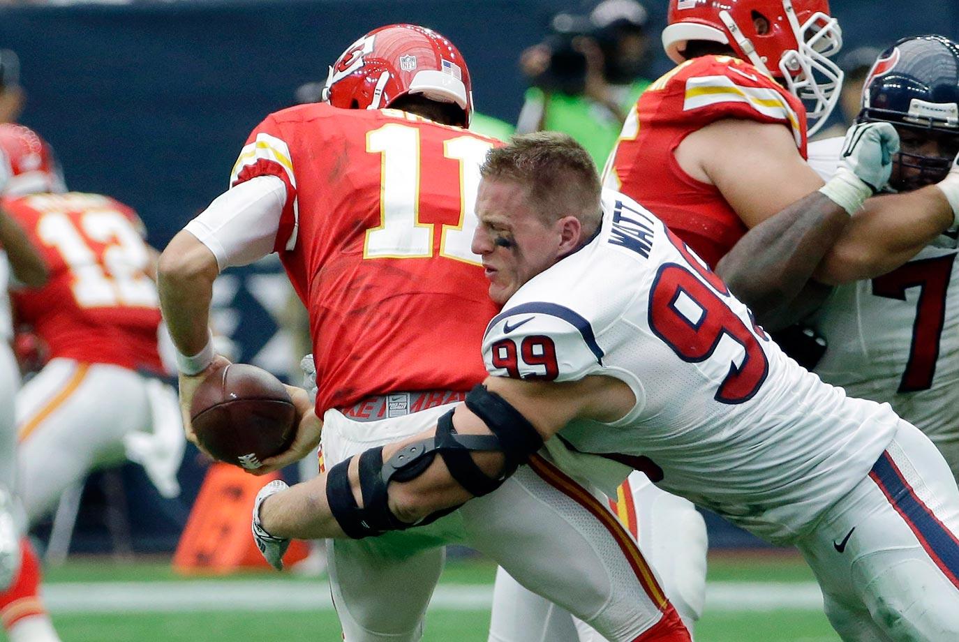 J.J. Watt of the Houston Texans sacks Alex Smith of the Kansas City Chiefs.