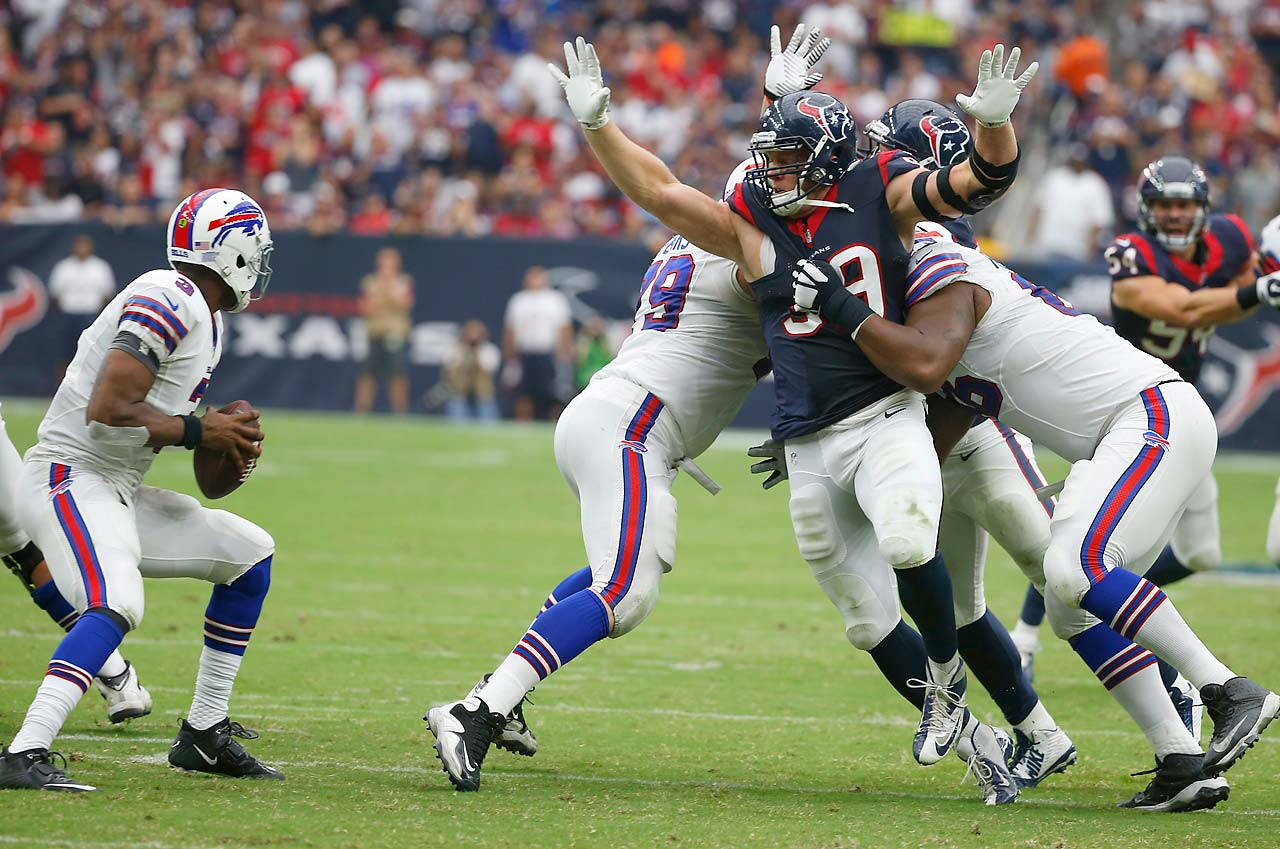 J.J. Watt pressures EJ Manuel during the Texans home win.