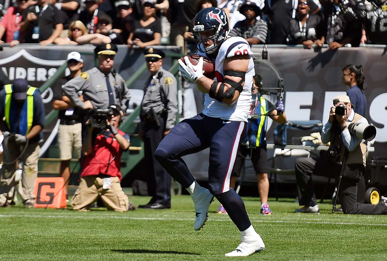 J.J. Watt of the Houston Texans catches a one-yard touchdown pass, the first of his career.