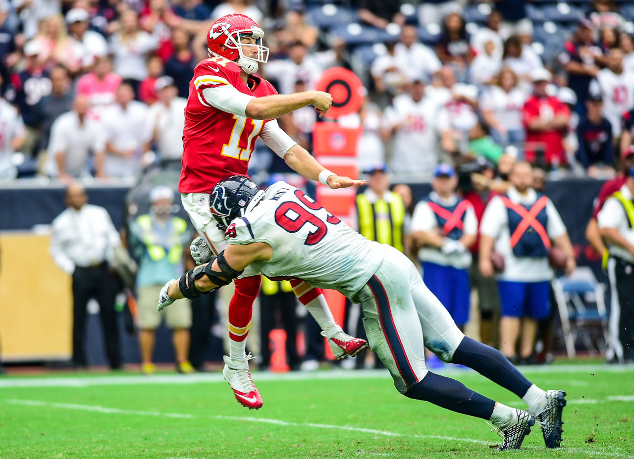 Houston Texans defensive end J.J. Watt lays a massive hit on Kansas City Chiefs quarterback Alex Smith.