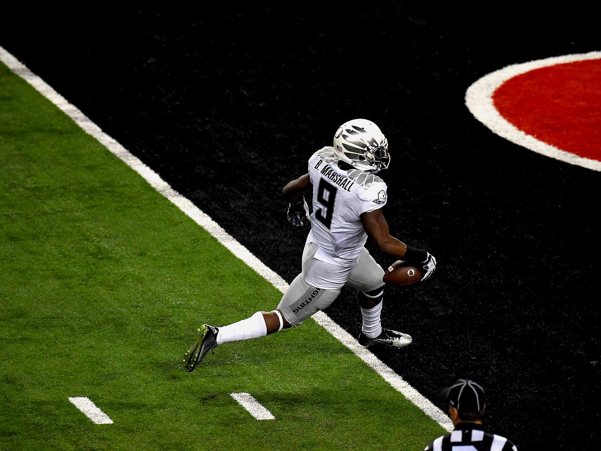 Replay officials took a close look to see if Byron Marshall let the ball go before he crossed the goal line on this play.