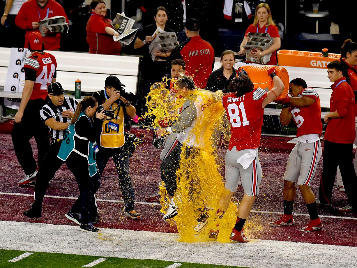 Coach Urban Meyer gets dunked with Gatorade by Nick Vannett at the end of the title game.