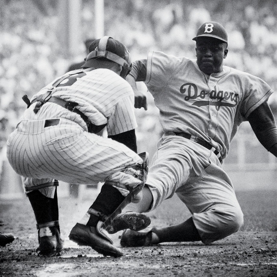 Jackie Robinson, the first player to break Major League Baseball's color barrier, steals home plate against Yogi Berra during Game 1 of the 1955 World Series on Sept. 28, 1955.  The Brooklyn Dodgers lost the game 6-5, but went on to beat the New York Yankees 4-3 in the series. (Posted Jan. 31 -- Robinson's 95th birthday)
