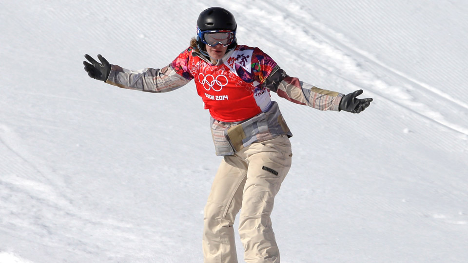 Lindsey Jacobellis of the United States crosses the line to win the small final of the women's snowboard cross at the Rosa Khutor Extreme Park, at the 2014 Winter Olympics, Sunday, Feb. 16, 2014, in Krasnaya Polyana, Russia.