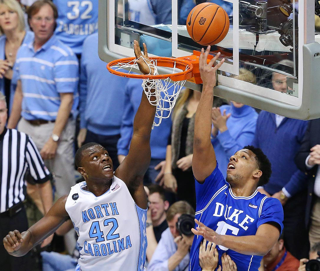 North Carolina's Joel James gets all net and not ball while trying to block a reverse layup by Duke's Jahlil Okafor.