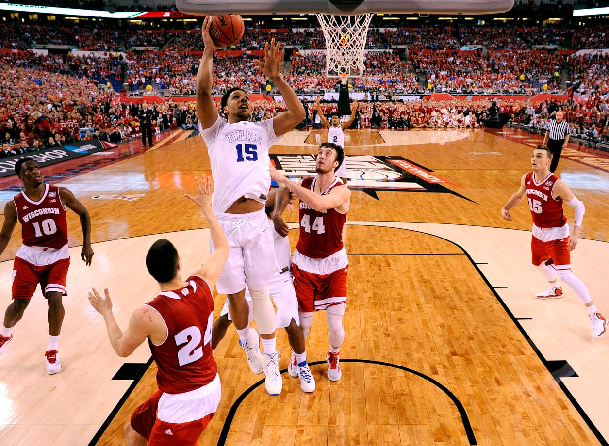Duke center Jahlil Okafor draws all eyes as he lifts a lay-up during Duke's national title game victory over Wisconsin.