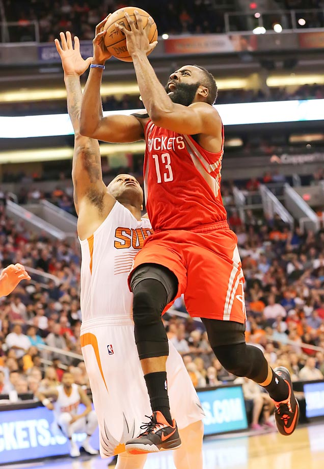 James Harden shoots against against the Phoenix Suns' P.J. Tucker at the U.S. Airways Center in Phoenix.