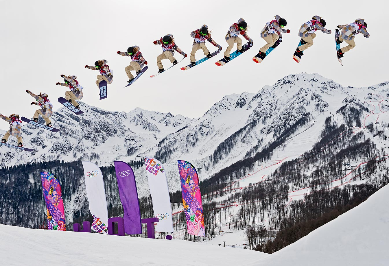 American snowboarder Jamie Anderson's jump during the ladies' slopestyle finals at the Olympics is shown in multiple exposures. Anderson won a gold medal in the competition.