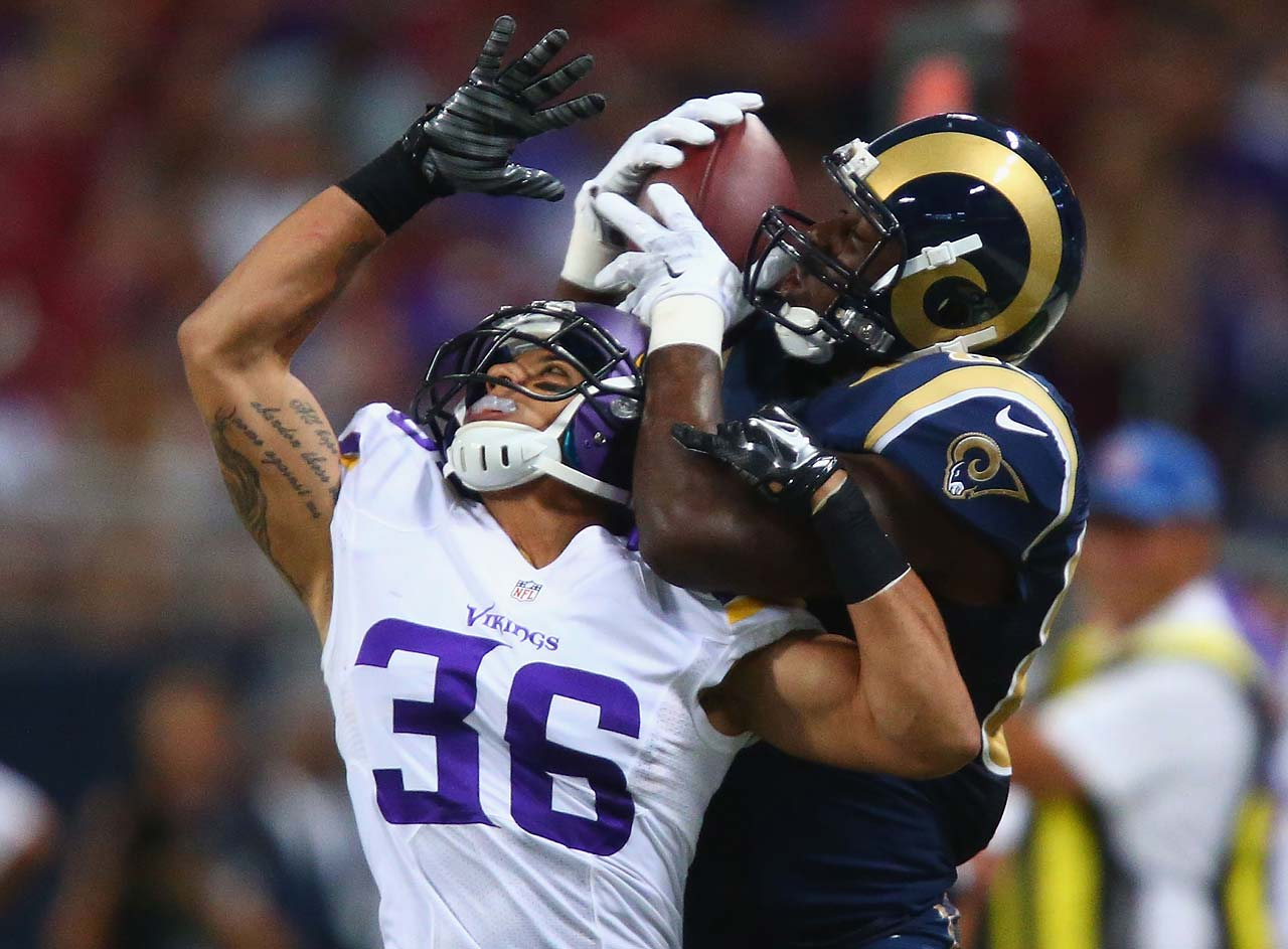 Jared Cook of the St. Louis Rams makes a catch against Robert Blanton of the Minnesota Vikings. The Vikings beat the Rams 34-6.
