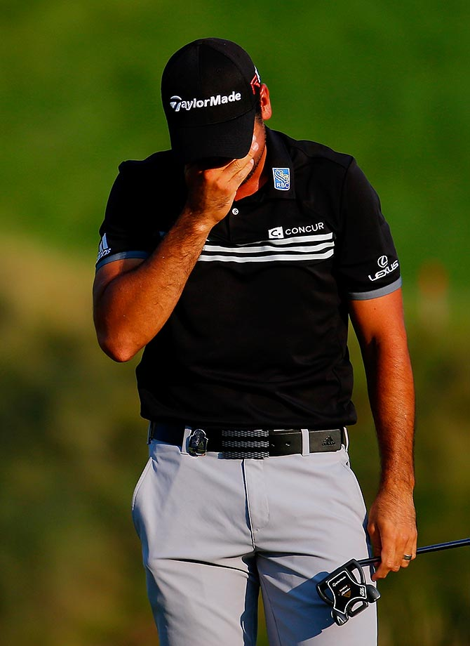 Jason Day of Australia cries on the 18th green after winning the 2015 PGA Championship with a score of 20-under par.