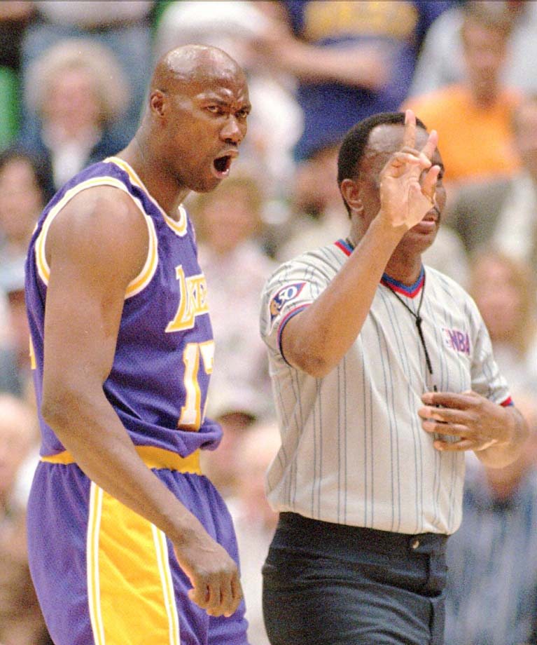 Jerome Kersey shows his displeasure to referee Hue Hollins in a 1997 game in Salt Lake City.