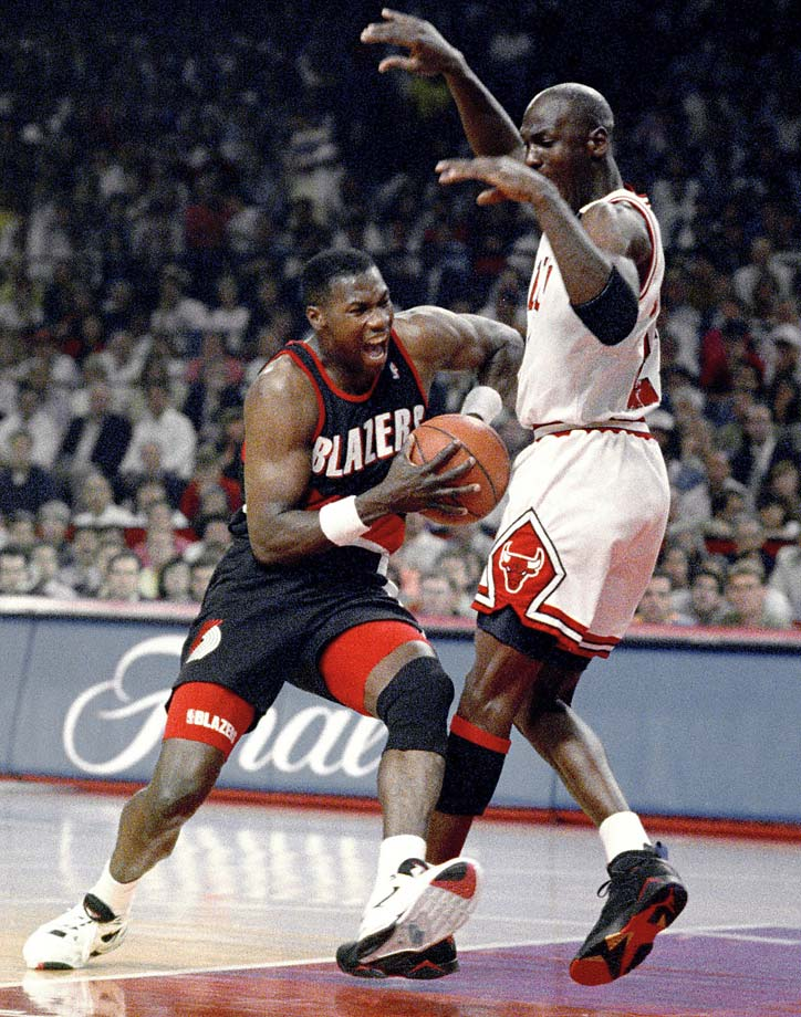 Michael Jordan tries to hold off Jerome Kersey during Game 6 of the 1992 NBA Finals.