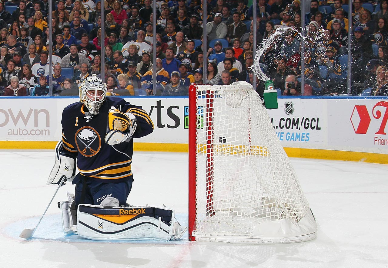 A goal by Jack Skille of the Columbus Blue Jackets sends water splashing from the bottle behind Jhonas Enroth of the Buffalo Sabres on Oct. 9.