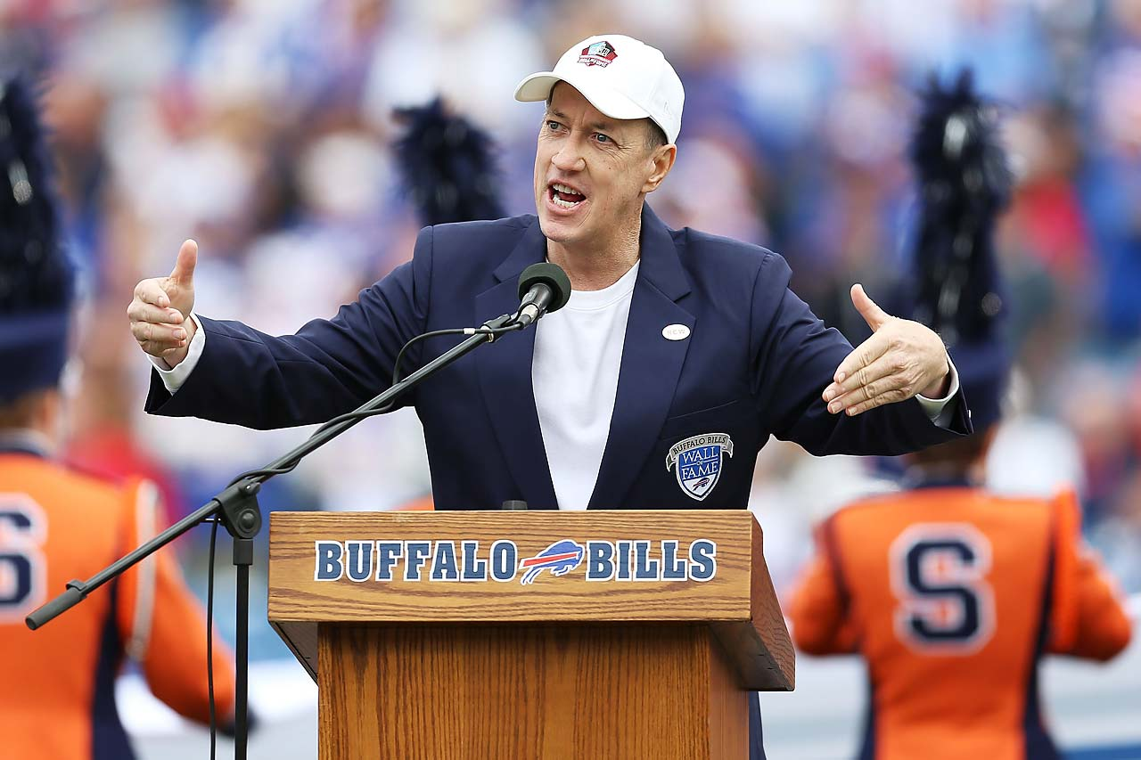 Former Buffalo Bills quarterback Jim Kelly talks to the crowd before the game between the Bills and the Miami Dolphins at Ralph Wilson Stadium. The Bills paid tribute to late owner Ralph Wilson, who died in March.