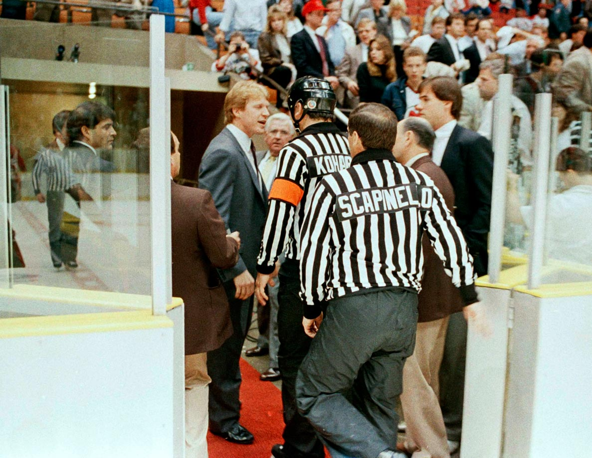 "New Jersey Devils coach Jim Schoenfeld verbally abused referee Don Koharski and blocked his exit from the ice following the Devils' 6-1 loss to the Boston Bruins in Game 3 of the Prince of Wales Conference Final at Brendan Byrne Arena on May 6, 1988 in East Rutherford, N.J. Koharski fell as the two argued, and when he finally headed away down the tunnel, Schoenfeld yelled: ""You fell, you fat pig! Have another doughnut! Have another doughnut!"""