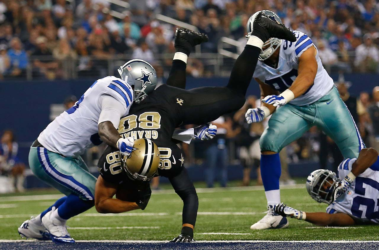 Jimmy Graham fumbles as he is hit by Justin Durant.