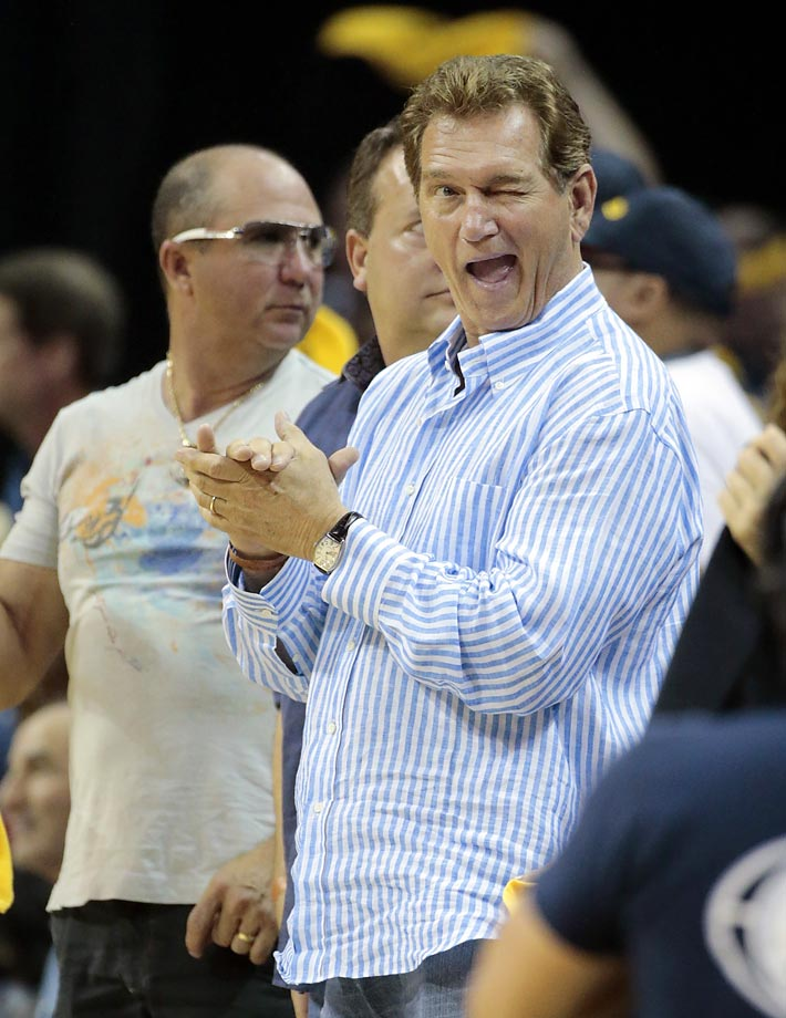 Former quarterback Joe Theismann winks at a friend as he watches the Grizzlies play the Trail Blazers in Memphis.