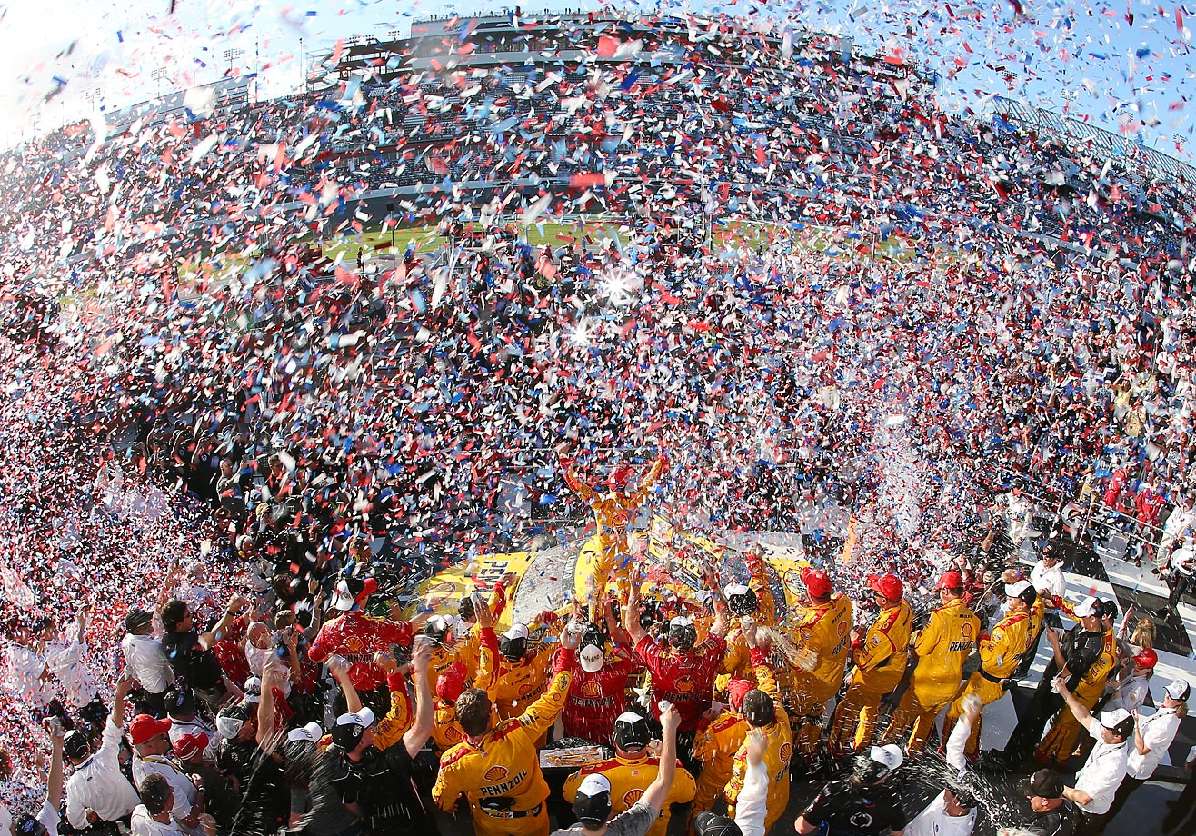 Joey Logano, driver of the No. 22 Shell Pennzoil Ford, celebrates in victory lane after winning the 57th Annual Daytona 500.