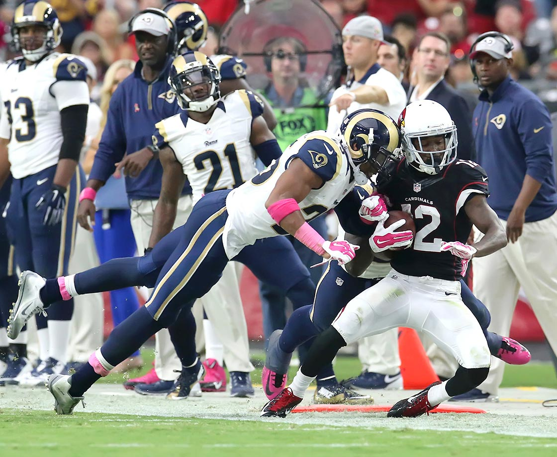 Rams safety TJ MacDonald hits Arizona wideout John Brown in the helmet out of bounds.