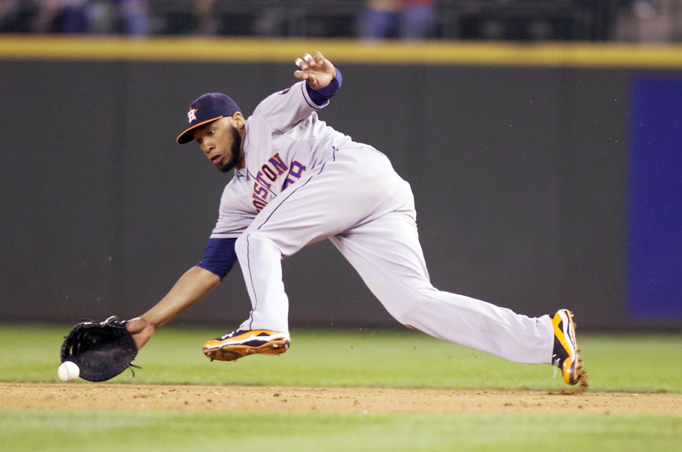 Houston Astros first baseman Jon Singleton tries to field a ground ball against the Seattle Mariners. He wasn't able to get the out.