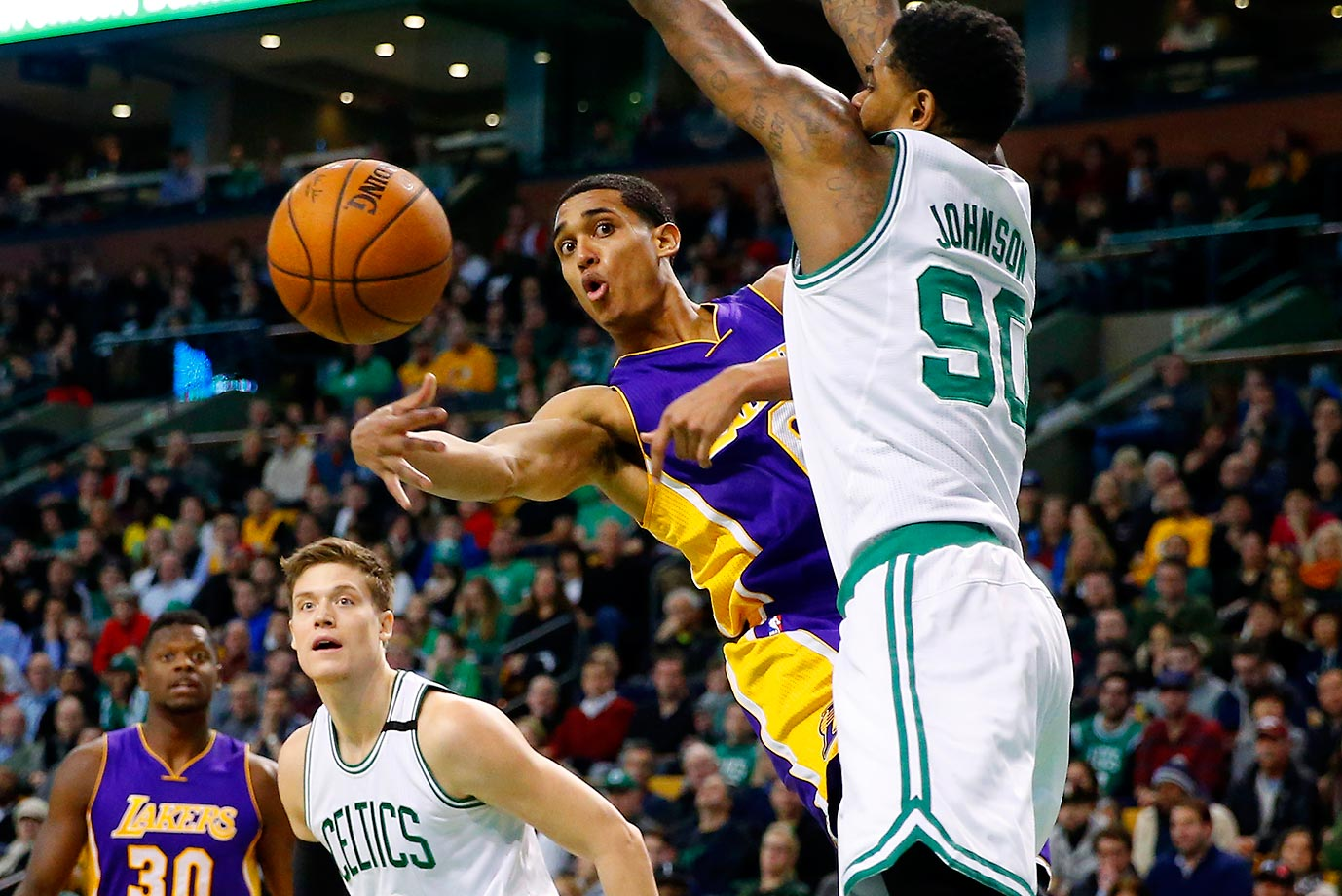 Jordan Clarkson of the Los Angeles Lakers makes a pass around Amir Johnson  of the Boston Celtics.