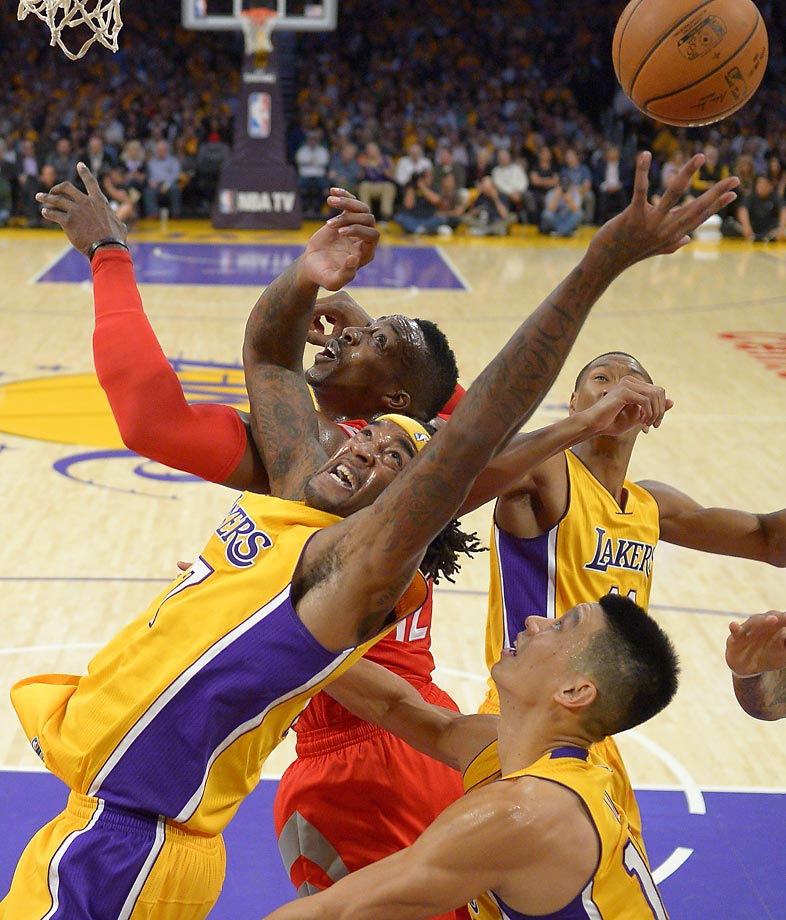 Los Angeles Lakers Jordan Hill and Houston Rockets Dwight Howard battle for a rebound.