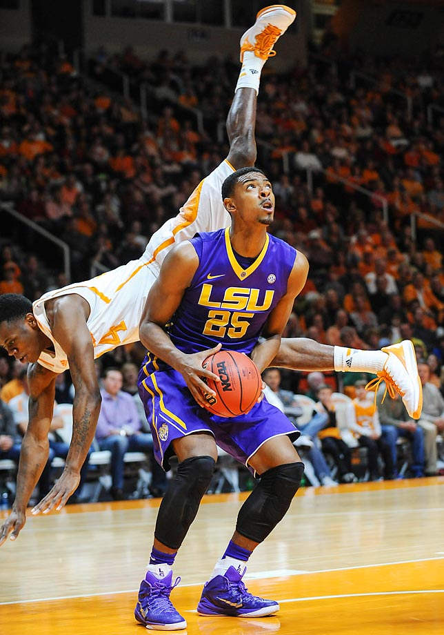 LSU forward Jordan Mickey fakes out Tennessee forward Armani Moore.