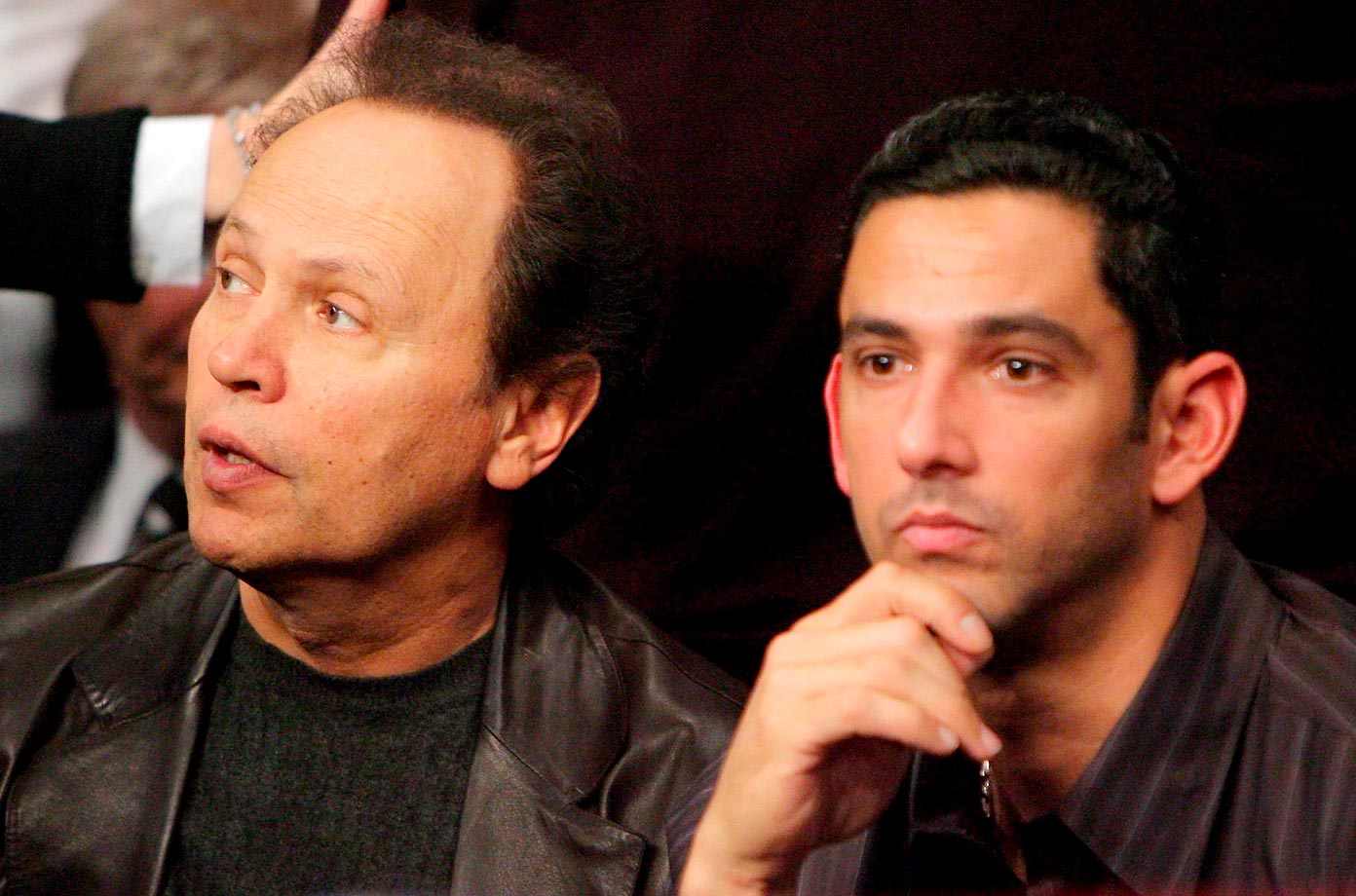 Billy Crystal and Jorge Posada sit together before the start of the fight between Miguel Cotto and 'Sugar' Shane Mosley.