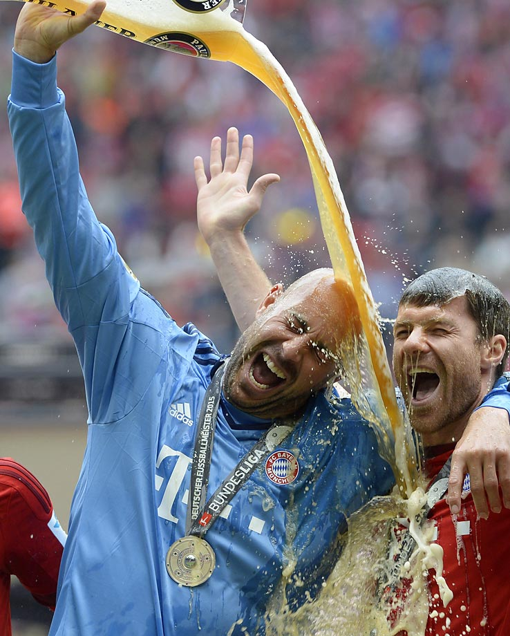 Bayern Munich goalkeeper Jose Manuel Reina and midfielder Xabi Alonso celebrate winning their 25th Bundesliga title.