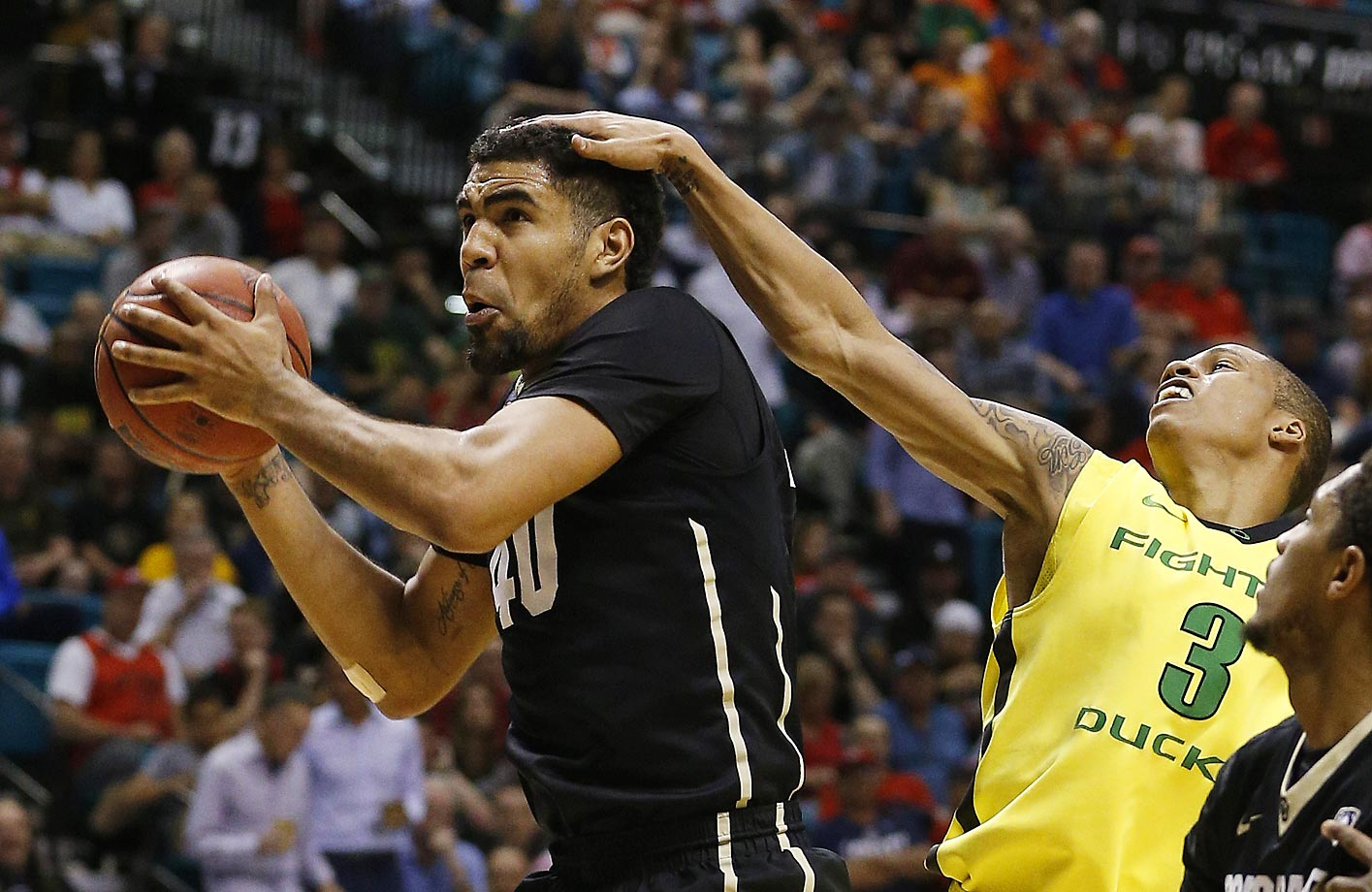 Josh Scott of Colorado gets a pat on the head by Joseph Young of Oregon.  Oregon won 93-85.