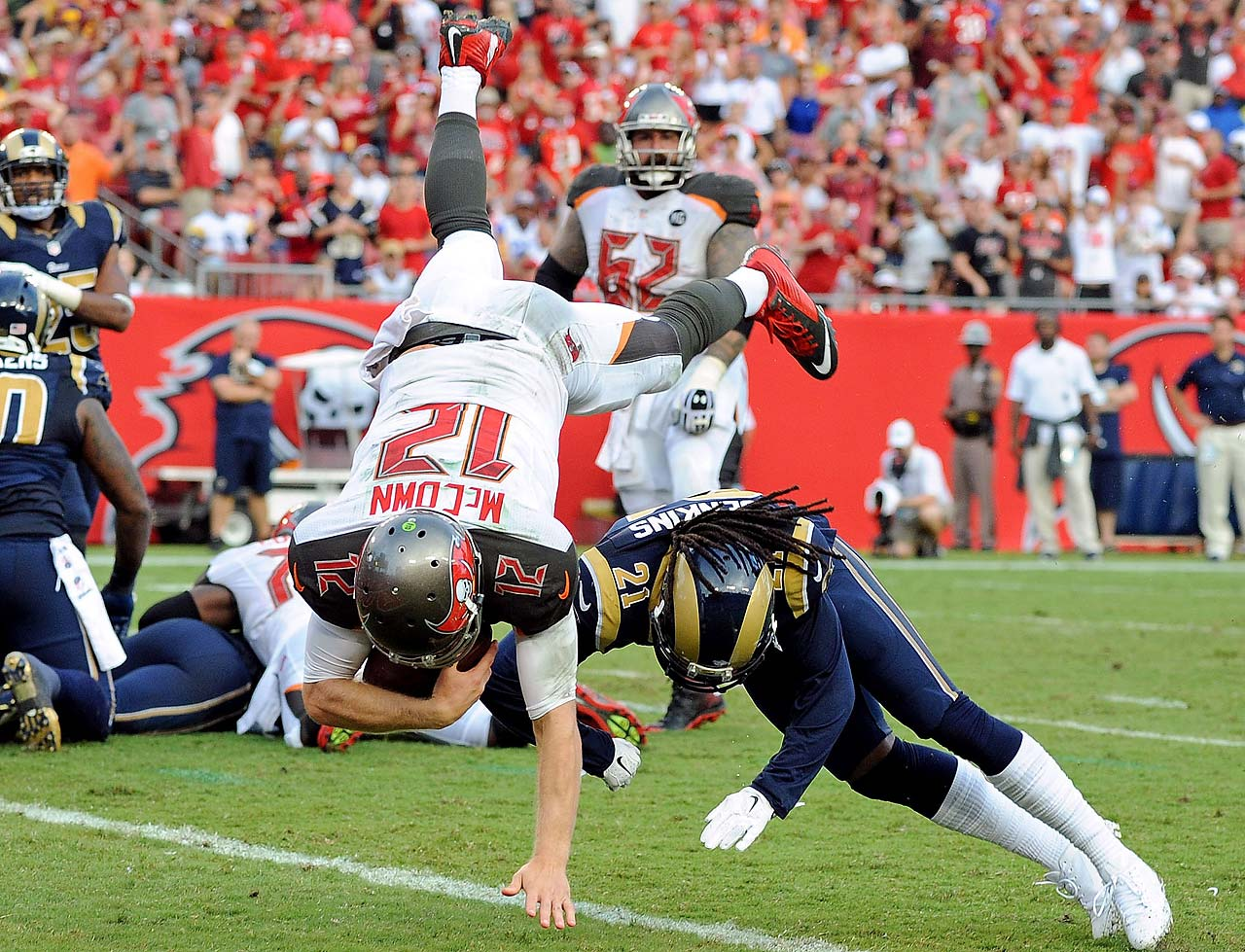 Josh McCown of the Tampa Bay Buccaneers flips into the end zone to score a touchdown against the St. Louis Rams.