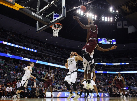 With five minutes to go in regulation, the No. 12 seed Arkansas-Little Rock Trojans trailed the No. 5 seed Purdue Boilermakers by 14. This was before Little Rock guard Josh Hagins scored 16 of his 31 points in the final 90 seconds of regulation and two overtimes. In that time he also had two of his six assists while scoring 10 of the Trojans' 15 overtime points. He scored a game-tying three-pointer for Arkansas-Little Rock as the clock showed five seconds to go in regulation, and he hit a game-tying layup with 18 seconds to go in OT. He also hit the go-ahead jumper in the second overtime.