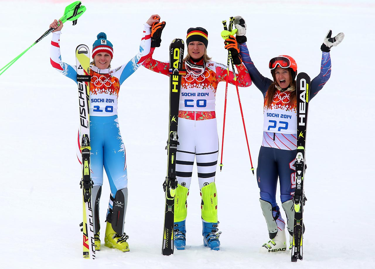 Silver medalist Nicole Hosp of Austria, gold medalist Maria Hoefl-Riesch of Germany and Julia Mancuso of the United States celebrate their performances.