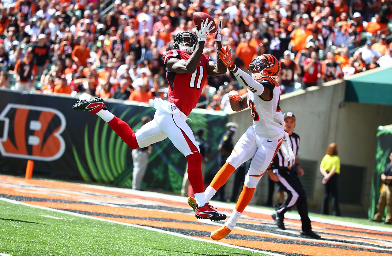 Atlanta wide receiver Julio Jones catches a 14-yard touchdown pass against Cincinnati free safety Reggie Nelson.