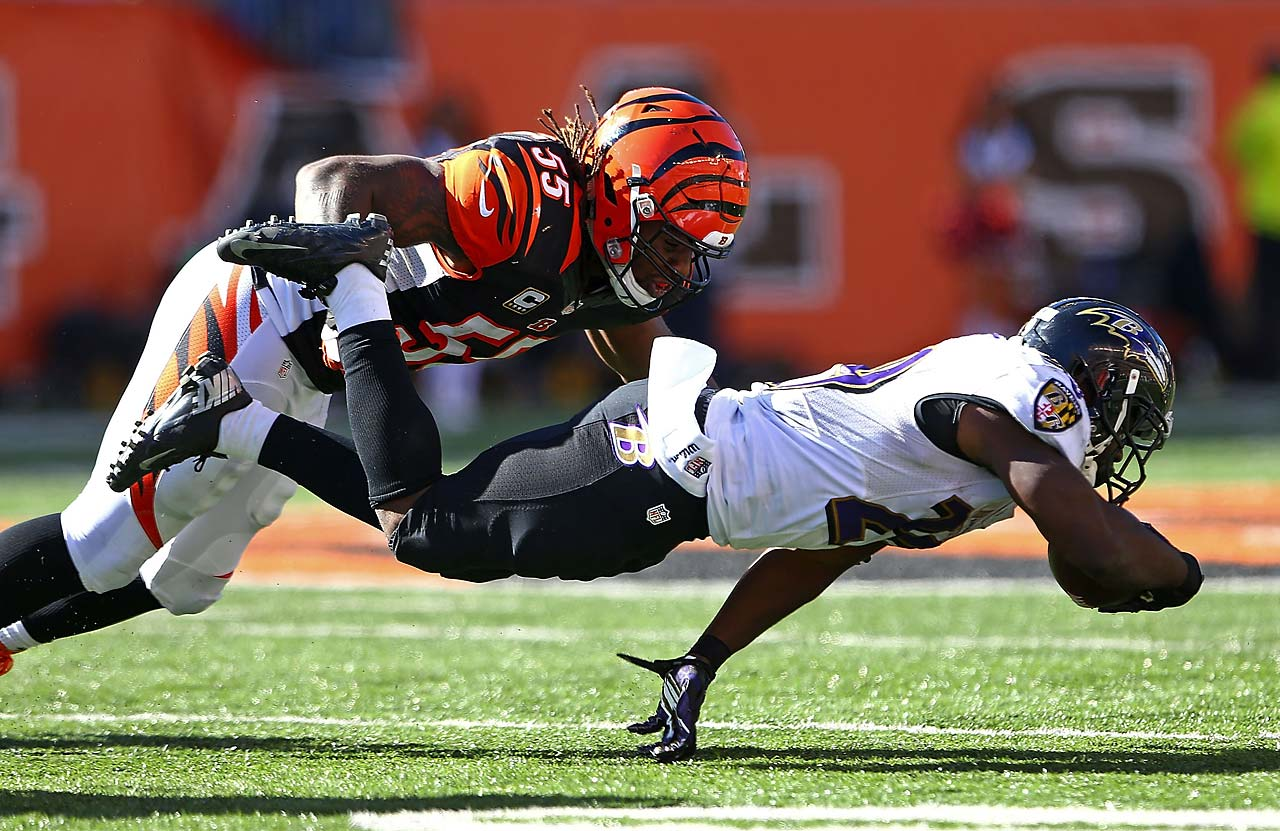 Vontaze Burfict of the Cincinnati Bengals tackles Justin Forsett  of the Baltimore Ravens during the Bengals win at home.