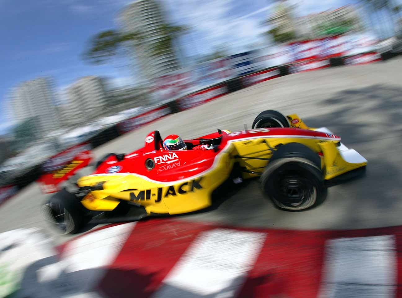 Moving to the U.S. in 2004, Wilson began racing in the Champ Car Series, going on to win four races (his first came in Toronto in 2005) plus three more after the series became IndyCar.