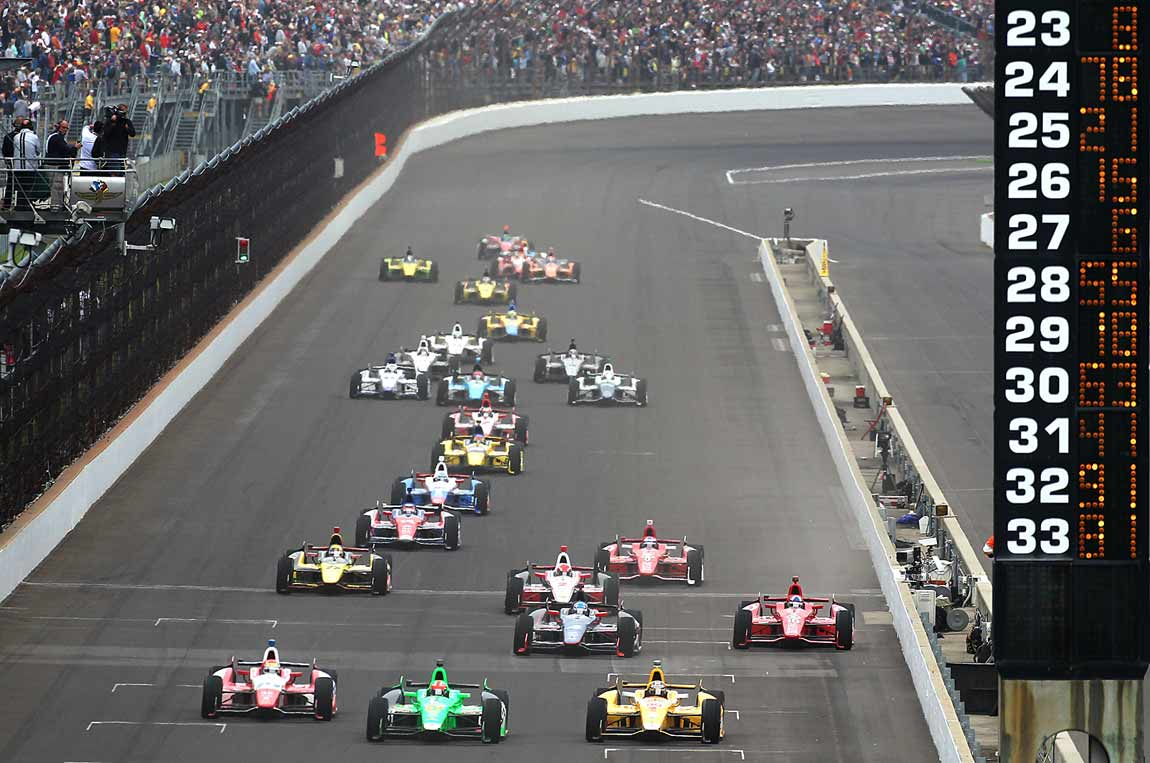 Wilson (front row, left) drove in the Indy 500 eight times, his best finish being fifth in 2013.